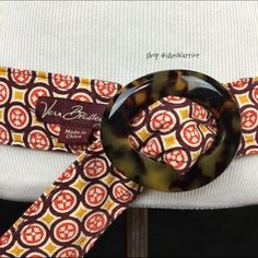 Vera Bradley reversible brown & orange print belt Super cute Vera Bradley belt in fun reversible prints of brown, orange, yellow and off white. Has brown tortoise buckle, soft cotton fabric, fully adjustable. One size. At first glance I thought this was a Tory Burch belt because the one orange print looked similar to her design, but indeed it's an authentic Vera Bradley, retired print. Great, new unused condition. Vera Bradley Accessories Belts