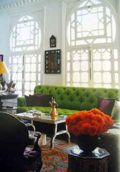 This is old world, with a sense of the 60's onward.  I love the bright green couch and the orangy-red blooms, and look at those windows - Wow this is very inspirational but way out of my grasp!  I'll look for the little things and go from there.ka.
