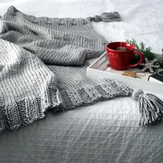 Company's Coming Knitting pattern by Fifty Four Ten Studio, a beautiful blanket project to add a hygge touch to your home! Find this pattern at LoveKnitting.Com.