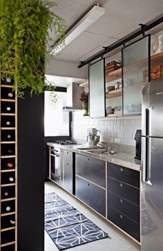 This kitchen keeps it light with opaque glass sliding cabinet doors. This kitchen keeps it light with opaque glass sliding cabinet doors. Kitchen Furniture, Kitchen Dining, Kitchen Decor, Long Kitchen, Glass Kitchen, Kitchen Storage, Office Furniture, Rustic Kitchen Design, Interior Design Kitchen