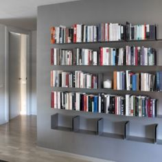 Modern shelving designed to fade into the background. The Santa Cole Noa Shelf is actually 2 shelves that can be installed separately or share a wall bracket as part of a larger modular system. The profile of each steel shelf is so thin that it becomes virtually invisible when filled with books, and appears to float on the wall when holding dishes, knickknacks or other items. Santa Cole is a Barcelona based company established in 1985 by Javier Santa, Gabriel Cole and Nina Maso. Their focus…