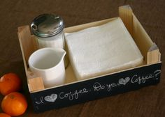 Clementine boxes make cute table top trays with the added touch of chalkboard paint.