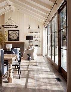 custom stained oak hardwood flooring and white washed exposed beams create a rustic ambiance