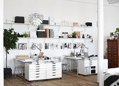 Really love the look of the wall shelves and desks with storage. -Sarah