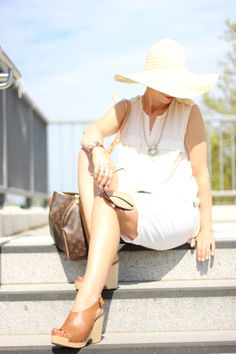 All white with Bermuda Shorts