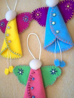 DIY Craft Inspiration: Felt angel all hand embroidered and beaded. A more simple version with fabric glue or a hot glue gun would be great for a kids craft project.