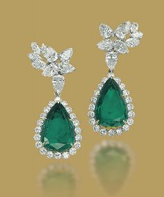 A PAIR OF EMERALD AND DIAMOND EARRINGS Each pendant set with a pear-shaped emerald in a brilliant-cut diamond surround to the pear-shaped and marquise-cut diamond cluster top, 5.5 cm, with French assay marks for platinum and gold