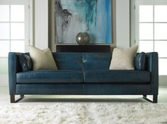 Modern blue leather sofa and gorgeous art work