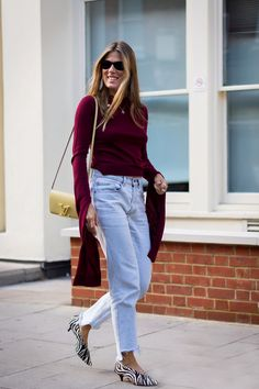 Natalie Hartley wears a burgundy top, bleached denim mullet jeans and zebra print pumps.