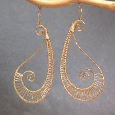 Nouveau 56 Hammered wired swirl drops, earrings by Calico Juno Jewels @ Etsy. i lobe this woman's jewelry - all of her work is so delicate and airy.