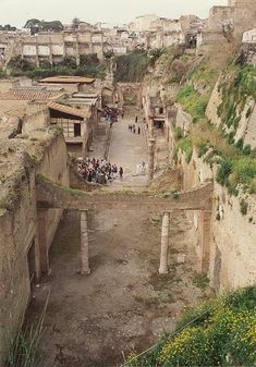 Herculaneum, Pompeii sister city, also buried in the eruption. Was hermetically sealed by the ash and lava so many items such as bone and wood were preserved, which was not the case with Pompeii. Ancient Ruins, Ancient Rome, Ancient History, Pompeii Italy, Pompeii And Herculaneum, Pompeii Ruins, Oh The Places You'll Go, Places To Travel, Places To Visit