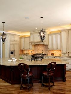 LOVE the lighting!! Would look amazing with stone on bottom half of island and some type of wrought iron stool....