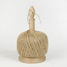 Handcrafted in rural Shropshire, England, from sustainably harvested hardwood, this combination twine stand and cutter is as practical as it is handsome, making it ideal for the serious gardener. The hand turned, white oak holder handily accommodates the oversized ball of pure jute twine, while the traditional bishop's hat finial houses a built-in cutter. Comes with one ball of twine, refills are available.