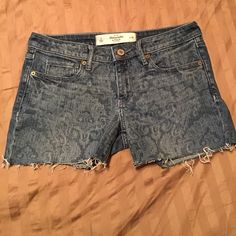 Abercrombie & Fitch shorts. Embossed EUC Abercrombie & Fitch shorts. Embossed print EUC. Destroyed hem. Size 2/26. 3 inch inseam. Abercrombie & Fitch Shorts Jean Shorts