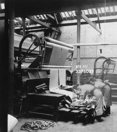 News Photo: Irish textile workers folding and starching linen at…