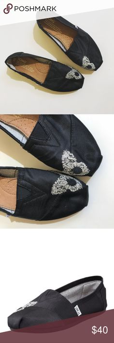 TOMS flats special edition Butterfly Black Super cute pair of Toms butterfly touch toe flats limited edition in black. From Neiman Marcus. In great pre-worn condition. Size 6. No trades! TOMS Shoes Flats & Loafers