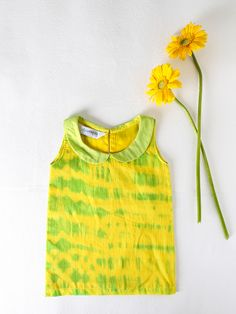 Peter Pan Dress in Tie n Dye Mul : The yellow with a splash of green is sure to add a touch of summer to your little one's wardrobe, while the mulmul will keep your child cool and cucumber. Buy Online @RedPolka