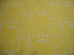 Elegant graffiti on a sunshine yellow background, part of Moda's Sphere quilting fabric line.