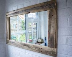 Bathroom Mirror made from reclaimed pallet wood with section for storage Dimensions:- 60cm long 49cm wide 12cm deep This item can be customised