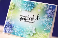 16 Sept 2016 : Doublestick Heaven : STAMPtember® Avery Elle-Christmas Cheer I embossed the beautiful snowflake images in clear onto watercolor cardstock and then blended distress inks all along the border. A few snowflakes were die cut with the coordinating dies and popped up for added dimension.