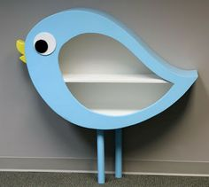 Birdy bookcase for waiting room i think it shoud be a cat cubby instead=so cute and different