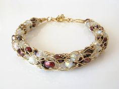 14K gold-filled wire crochet bracelet with cranberry pearls and frosty white crystals in a spiral, candy-cane design, by DianaShyeJewelry,