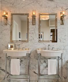 Stunning master bathroom features framed inset medicine cabinets flanked by polished nickel sconces on white and gray marble wall over washstands with white porcelain sinks. Bathroom Renos, Bathroom Fixtures, Master Bathroom, Bathrooms, Marble Wall, Gray Marble, Bathroom Inspiration, Bathroom Inspo, Interior Inspiration