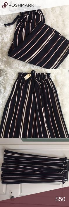 High Waisted Flowy Pants Selling for my sister. Brand new with tags. Purchased from a store in Malibu called Burro. Adorable high waisted striped pants with ruffles at the waist. Comes at about the waist and the pants end a little above ankle. Navy blue pants with white and red stripes. Very nice material Lush Pants