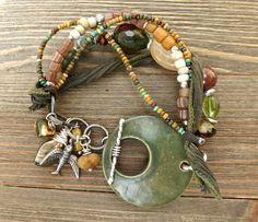 Mossy green. Charm bracelet with stone, ceramic clasp, Czech glass, glass seed beads and silver metal jewelry.