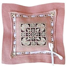 Reticello is an ancient form of Italian needlelace dating from the 15th century. This gorgeous linen fragrance pillow features drawn thread work, needle lace stitches, pea hole hemstitch, counted satin stitch and a rolled hem.