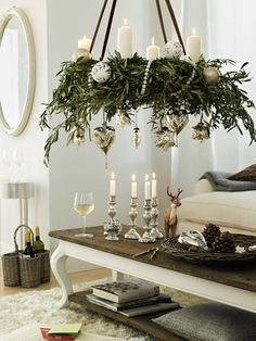 Love the use of candles in that hanging wreath, but what about wax melt? Use Candle Impressions flameless candles to protect your house and furniture from wax and fire damage. This could even be done as a DIY!