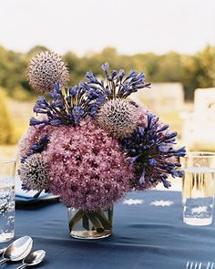 Stunning centerpiece made of allium, agapanthus and globe thistle.