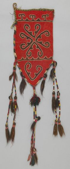 Object Name: Tent Pole Cover Place Made: Asia: Central Asia, Afghanistan, Northern Afghanistan People: Kirghiz or Kazakh Period: Mid 20th century Date: 1930 - 1970 Dimensions: L 56 cm x W 29 cm Materials: Wool; hair Techniques: Felted; embroidered; tasseled