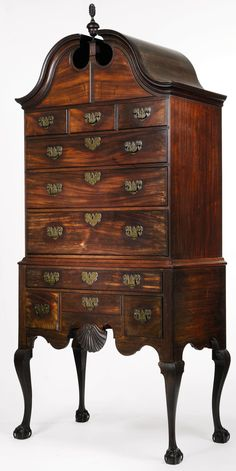 "Lovely and rare mahogany American ""highboy"" made around 1756. It has wonderful ""open"" claw and ball feet,  a fabulous broken arch pediment and ornately carved shell. This is a $3,500,000 million piece of museum quality American furniture. Rare and exquisite. This is the quality of American furniture that one sees in museums and also in the White House."