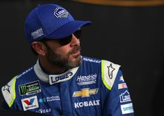 Jimmie Johnson Photos Photos - Jimmie Johnson, driver of the #48 Lowe's Chevrolet, stands on the grid during qualifying for the Monster Energy NASCAR All-Star Race at Charlotte Motor Speedway on May 19, 2017 in Charlotte, North Carolina. - Charlotte Motor Speedway - Day 2