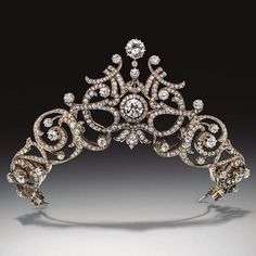 A diamond belle epoque tiara necklace combination, circa 1905 and probably French, featuring foliate scrolls flanking a central diamond motif.
