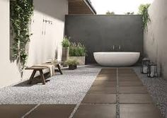 Evolve your outdoor space with the innovative Architech Porcelain Pavers. - Evolve your outdoor space with the innovative Architech Porcelain Pavers. Lay with ease on gras - Tile Patio Floor, Patio Flooring, Padang, Black Tiles, White Tiles, Ceramica Tile, Outdoor Paving, Indoor Outdoor, Home Reno