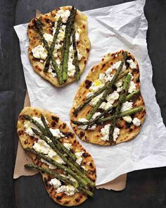Grilled Asparagus and Ricotta Pizza-  Tender grilled asparagus and soft ricotta cheese top this grilled pizza. No grill? no problem. Cook this dough in a cast-iron skillet over high heat, or on a preheated sheet pan or pizza stone in a 500-degree oven.