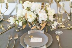 modern place setting - photo by Amanda Jameson Weddings http://ruffledblog.com/modern-wedding-inspiration-with-grey-and-gold