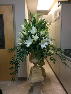 Saint Joseph feast day White lilies 20 stems and 5 stems of Ruscus