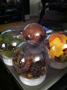 Artifact Globes! Great way to let infants and toddlers experience nature indoors. I am totally going to use these for my classroom. And I can change them as often as I want for the themes.