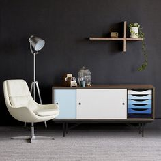 Icy blue sideboard with sliding doors and hidden stacked drawers. Classy!