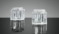 Jean-Michel Frank 1895 - 1941 DEUX ENCRIERS, VERS 1935 A PAIR OF ROCK CRYSTAL INKWELLS BY JEAN-MICHEL FRANK, CIRCA 1935 THE JEAN-MICHEL FRANK COMMITTEE WILL PROVIDE A CERTIFICATE FOR THIS LOT UPON THE BUYER'S REQUEST UNDER THE USUAL CONDITIONS. cristal de roche, de forme cubique, avec couvercles Hauteur : 6,3 cm (2 1/2 in.) Largeur : 7 cm (3 in.) Profondeur : 7 cm (3 in.)