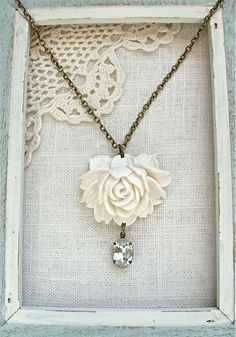 Antique white blooming flower necklace.  Long 25 inch chain with large flower and vintage rhinestone.  Antique brass