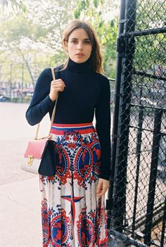 Ana Kras in her own turtleneck, Gucci printed skirt, and Gucci Padlock bag