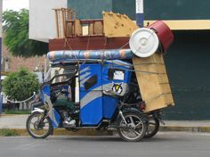 Mototaxi packed to the limit....Peru in so many ways!