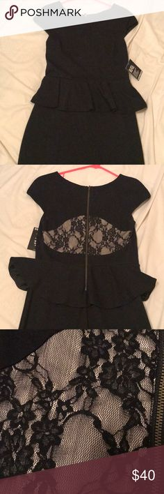 Classy black peplum style dress. Classic black peplum style dress with lace back detail. The lace section is lined and is not see through. never worn! Express Dresses Midi