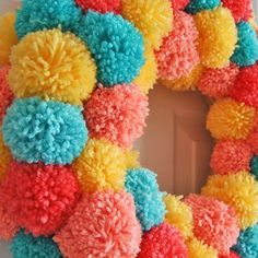 What a statement this wreath will make on your door! Learn how to make an easy colorful pom pom wreath for Spring, step by step at Sparkles of Sunshine. Pom Pom Wreath, Easter Bunny, Easter Eggs, Easter Wreaths, Easter Baskets, Diy Crafts, Sparkles, Crafty, Sunshine