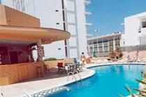 £100pp, AND a free cocktail on arrival at the Poniente Playa Apartments in San Antonio, Ibiza