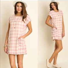 "Pretty In Pink Plaid Perfect for the spring time! Pink and cream mixed plaid with pocket detailing by the waist. The seam lines are slightly frayed to add some simple detailing. Made of a cotton and poly blend. Sizes M embellished. Measurements: bust 42"" length 35"" Dresses"